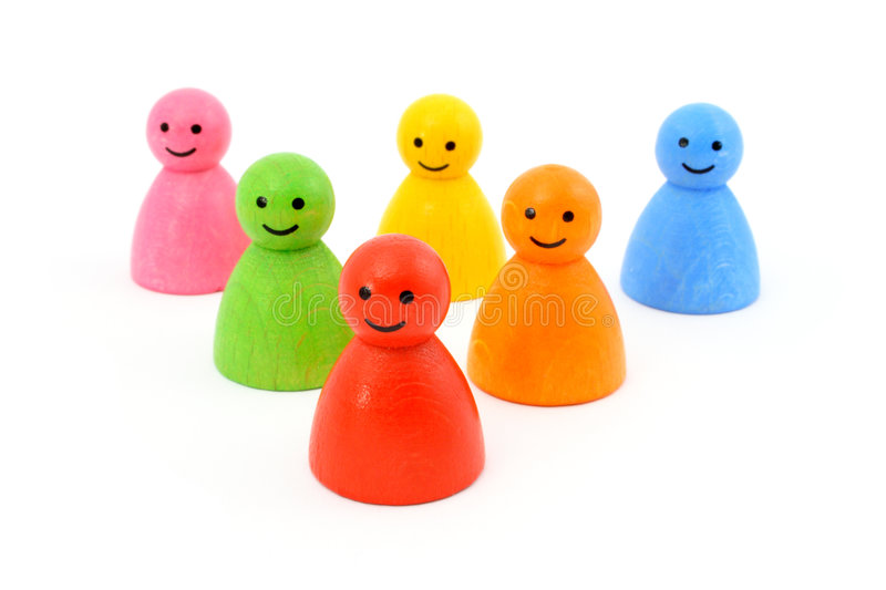 Colorful gaming pieces smiling. Six colorful gaming pieces smiling. Isolated on white royalty free stock image