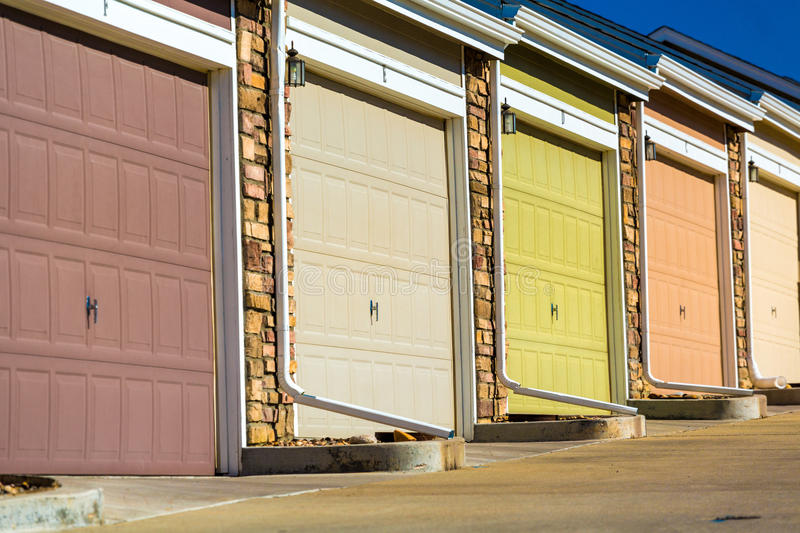 Colorful garage doors in a raw . & Colorful garage doors stock image. Image of brick house - 55561375