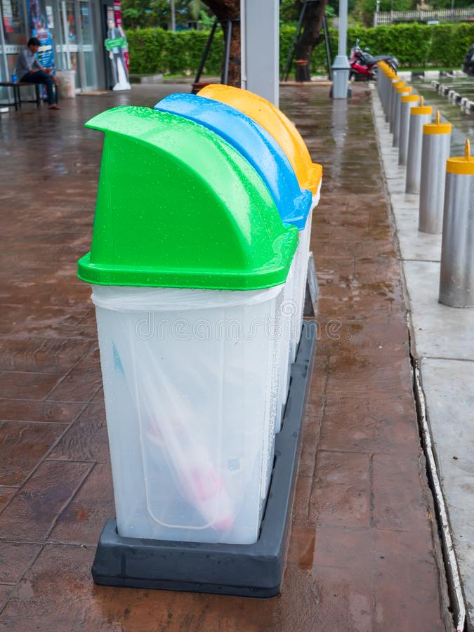 Colorful garbage bin at the rain and wet place royalty free stock images