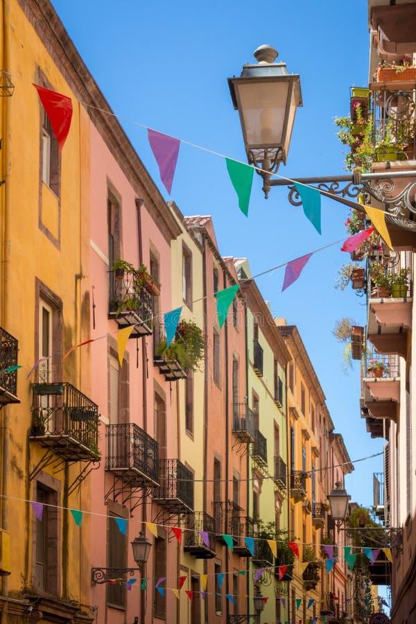 Colorful garland decoration in narrow street. Colorful garland decoration in the old town of Bosa on the Italian island of Sardinia royalty free stock photo