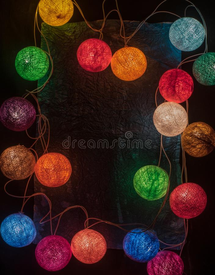 Colorful garland with space for text on the black background stock photo