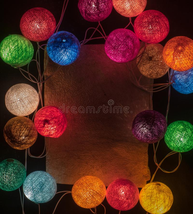 Colorful garland with space for text on the black background stock image