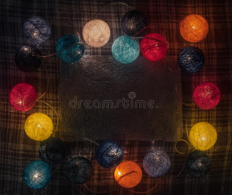 Colorful garland with space for text on the caged background stock photo