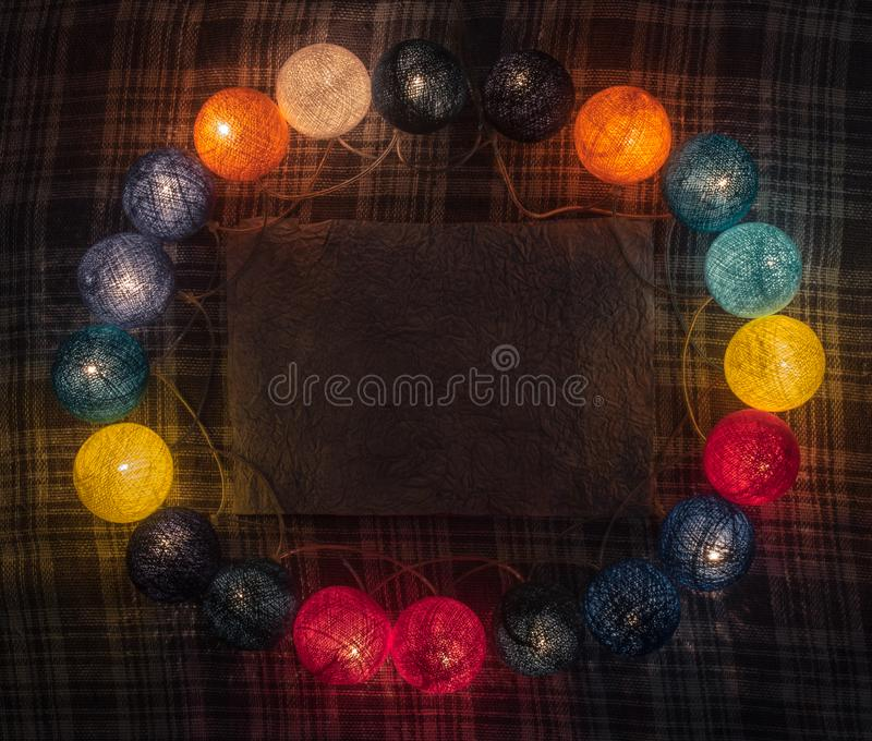 Colorful garland with space for text on the caged background stock photography