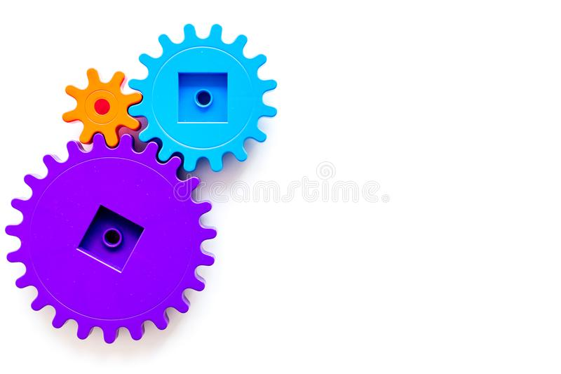 Colorful gears for ideal team work technology white table background top view mock-up. Colorful gears for ideal team work technology on white table background stock image