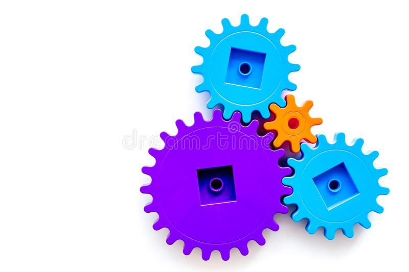 Colorful gears for ideal team work technology white table background top view mock-up stock images