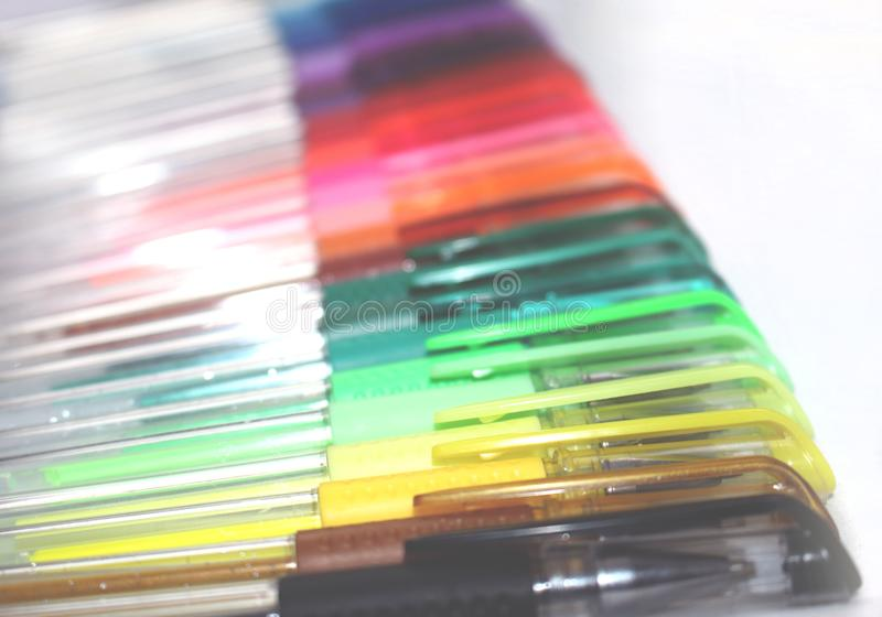 Colorful gel pens laid down in a horizontal row stock image