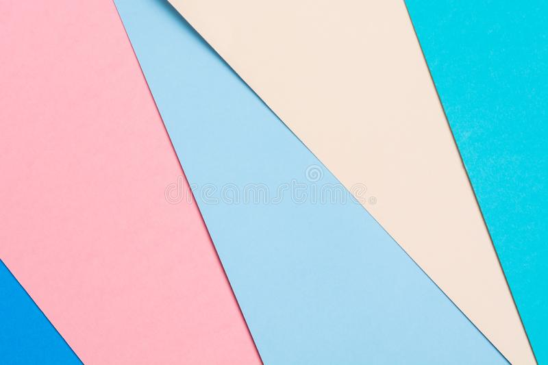 Colorful geometric paper background. Origami concept of five paper colors. Textured pastel backdrop royalty free stock photos