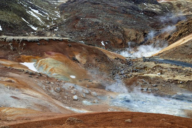 Seltun geothermal area in Iceland. Bubbling mud pools and steaming hot springs. Colorful geothermal area called Seltun. Bubbling mud pools and steaming hot stock photos