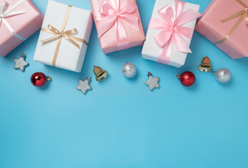 Colorful gift boxes decoration on blue background with copy space. Christmas, Birthday and New year concept stock image