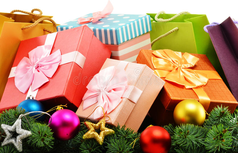 Colorful gift boxes and paper bags on white. Background royalty free stock photography