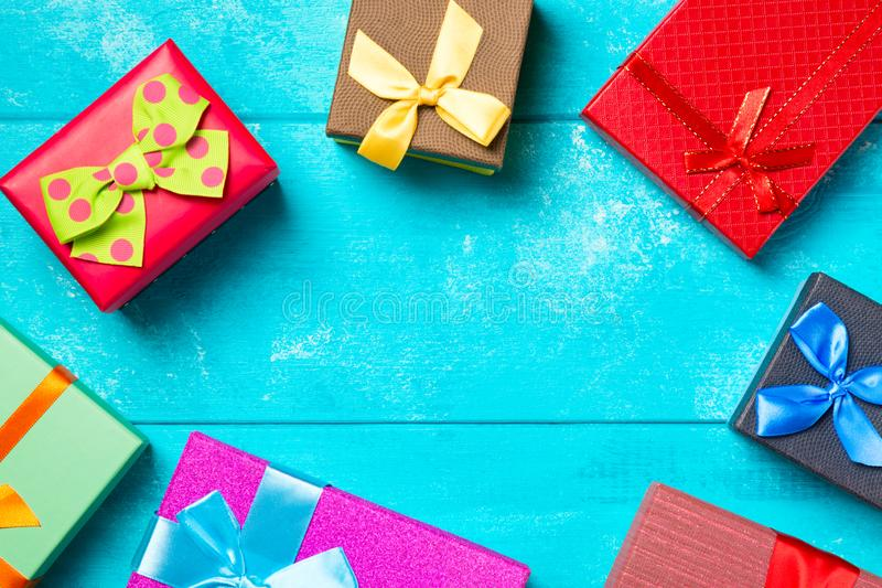 Colorful gift boxes with ribbons on nice blue wooden background. Copy space. Christmas or birthday celebration holiday theme.  stock photos