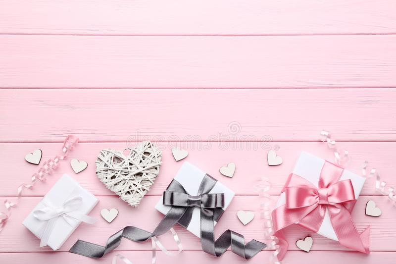 Gift boxes with white hearts royalty free stock image