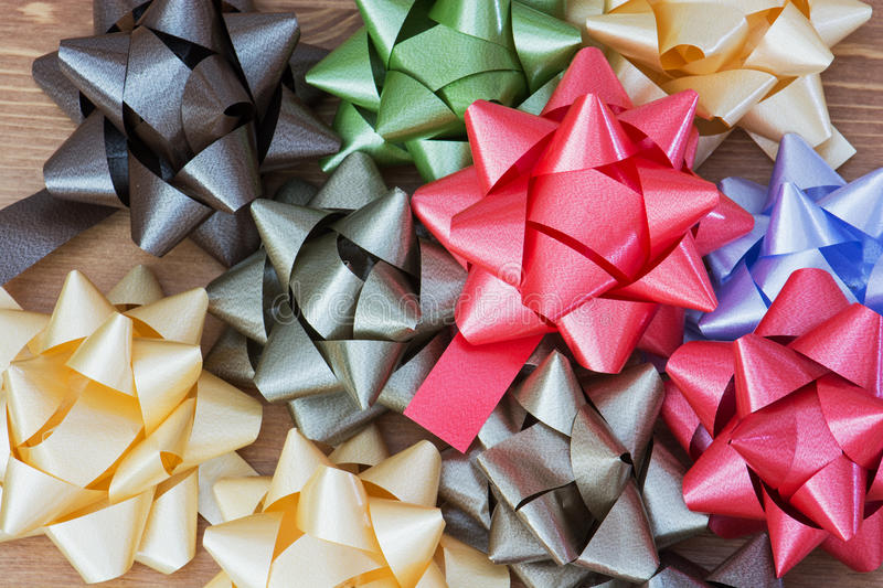 Colorful gift wrap bows. On the wooden table royalty free stock photo