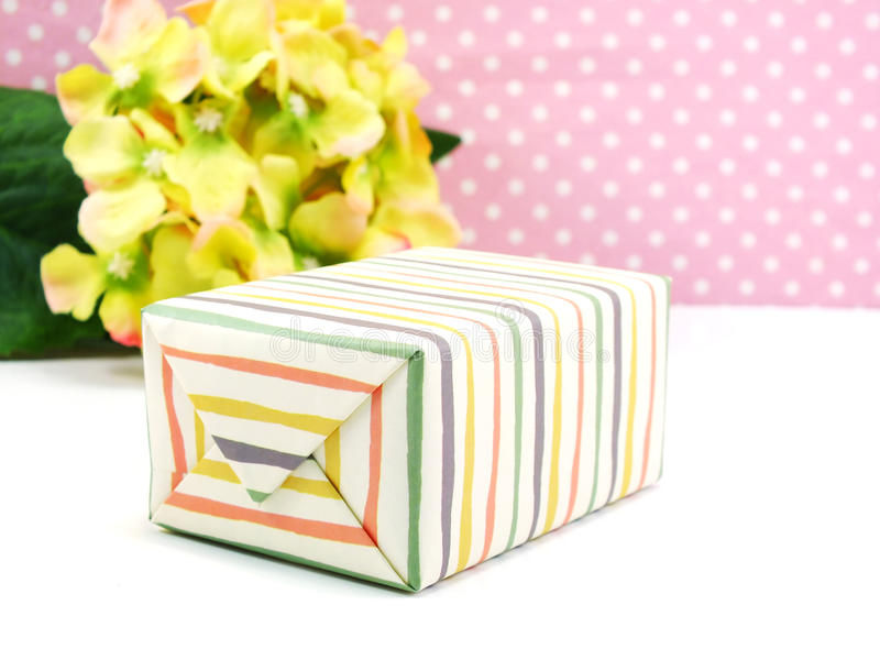 Colorful gifts box and beautiful flower stock photos