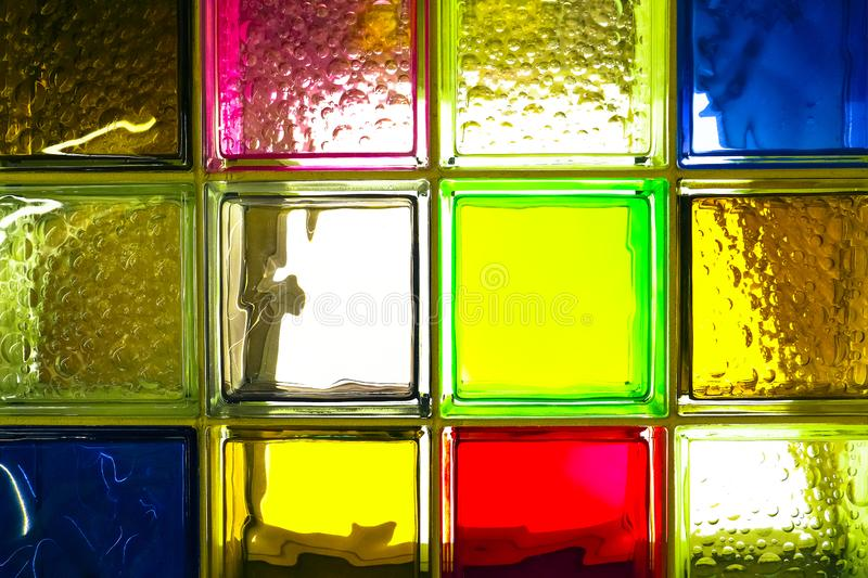 Colored glass blocks. Colorful glass blocks panel for background pattern. royalty free stock photo