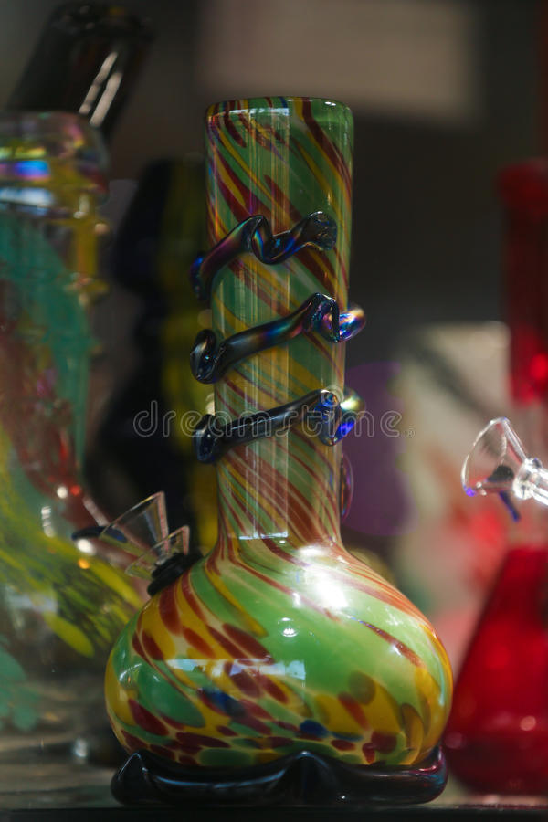 Colorful glass Bong. On a table stock photos