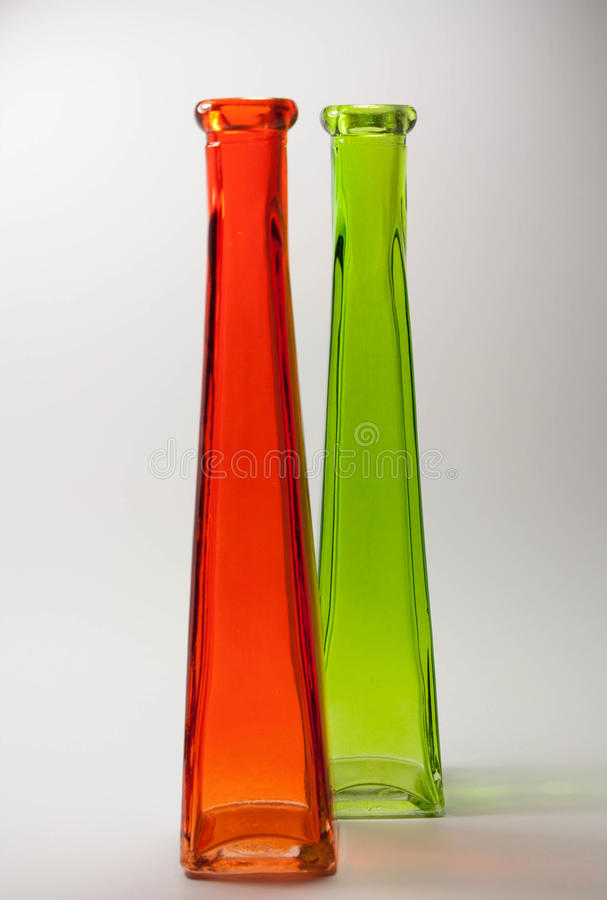 Colorful glass bottles in red and green royalty free stock photo
