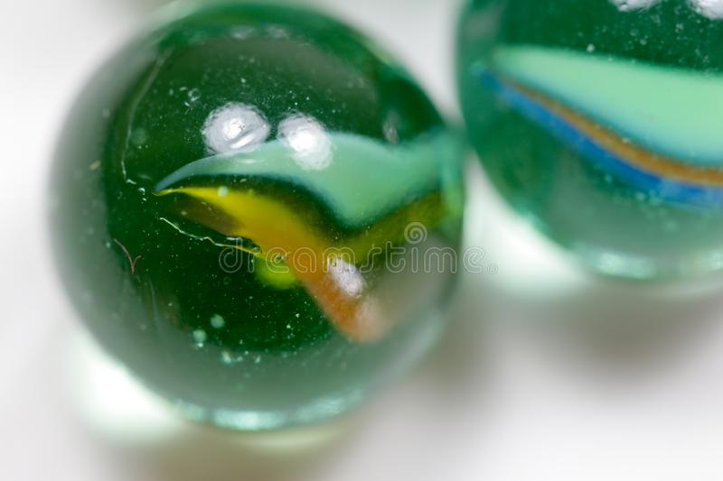 Colorful glass marbles. A hard crystalline metamorphic form of limestone, typically white with or streaks of color, that is capable of taking a polish and is stock photo