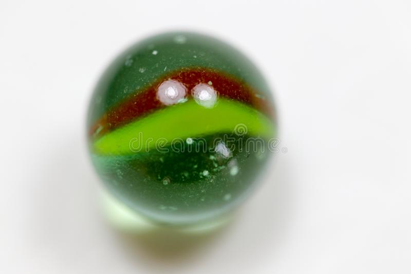Colorful glass marbles. A hard crystalline metamorphic form of limestone, typically white with or streaks of color, that is capable of taking a polish and is royalty free stock image