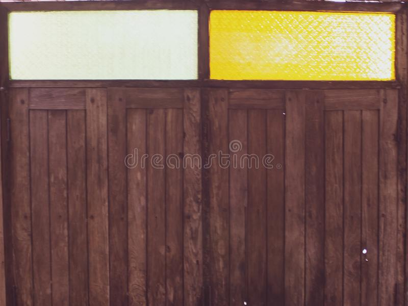 Colorful glass over old wooden window royalty free stock images