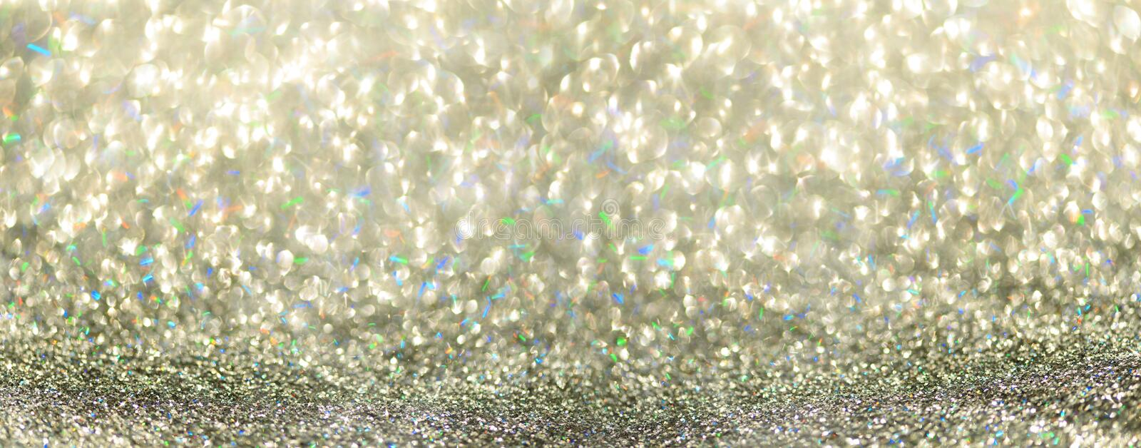 Colorful glitter banner with lights, bokeh. Shiny festive greeting card. New year and Christmas concept. Sparkling textured stock photos