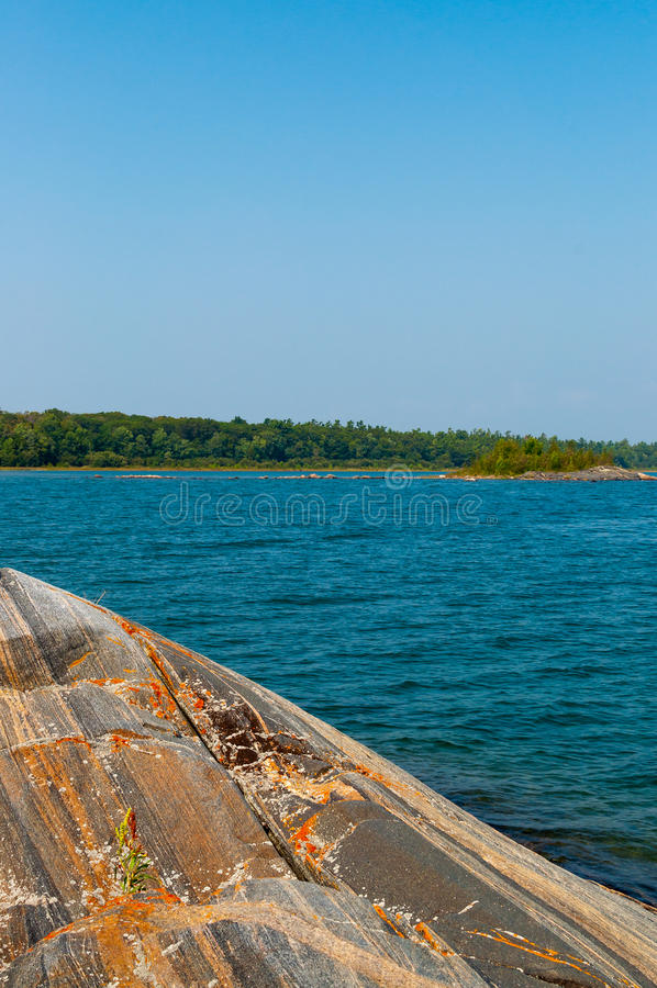 Colorful gneiss rock on Georgian Bay royalty free stock photography