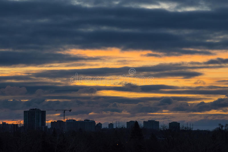 Colorful golden sunrise dawn Toronto, Scarborough, Canada. Beautiful colorful golden sunrise in the Scarborough city skyline during a cold Winter morning stock images