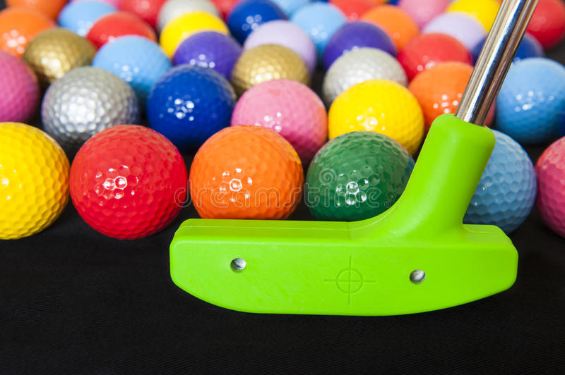 Colorful Golf Balls with Green Club stock image
