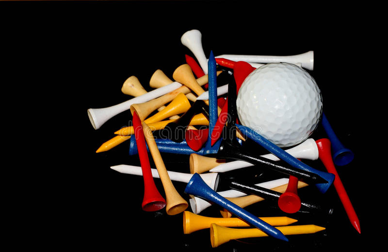 Colorful golf tees with golf ball royalty free stock photos
