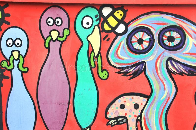 The colorful graffiti on the wall of the tunnel royalty free stock photo