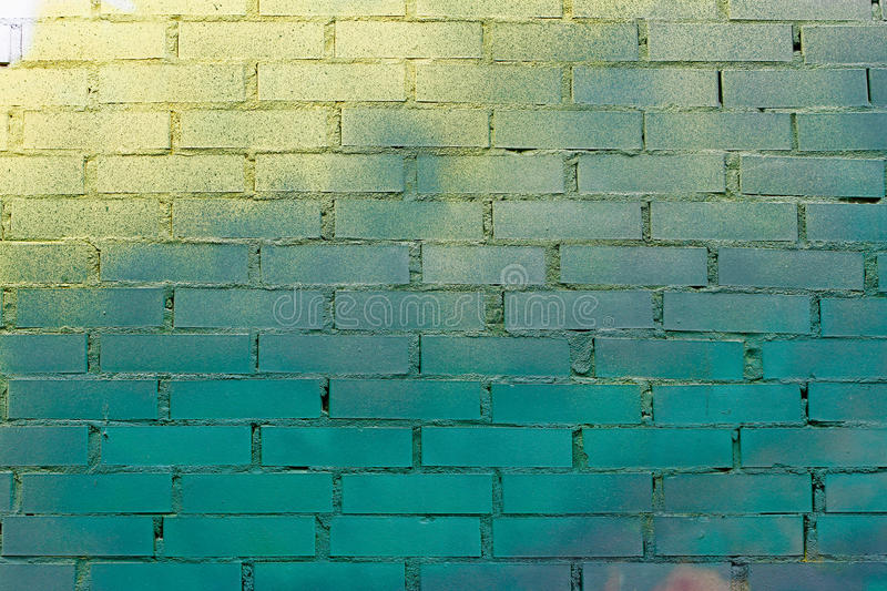 Colorful green, blue and yellow brick wall. As background or texture royalty free stock photo