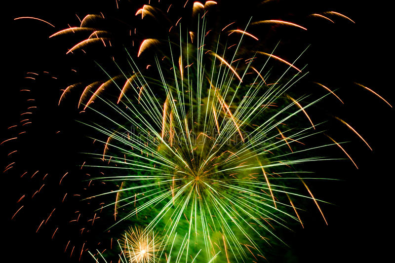Colorful green fireworks on the black sky stock images