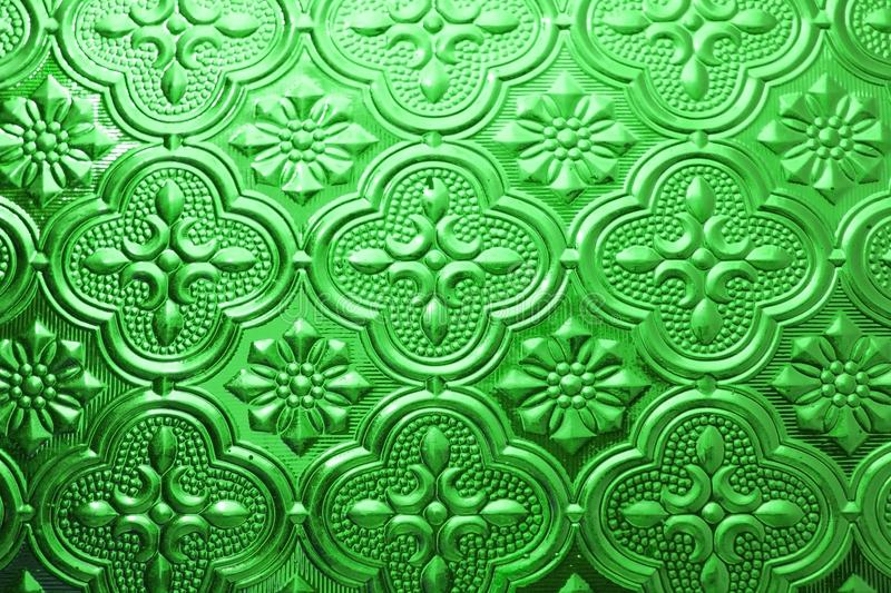 Colorful green seamless texture. Glass background. Interior wall decoration 3D wall pattern abstract floral glass shapes stock photos