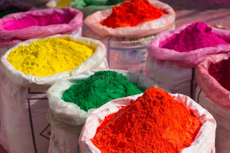 Colorful gulal powder in gunny bags ready for sale on hindu indian festival of holi royalty free stock images