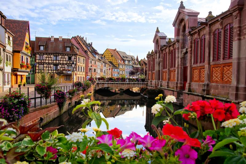 Colorful houses along a canal with flowers, Colmar, Alsace, France stock image