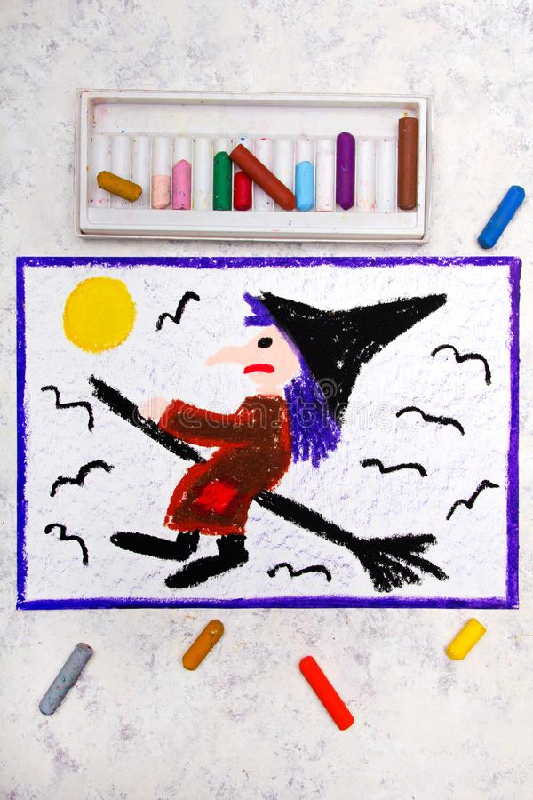 Colorful hand drawing: Old ugly witch flying on a broom. Halloween drawing on white background royalty free stock photography