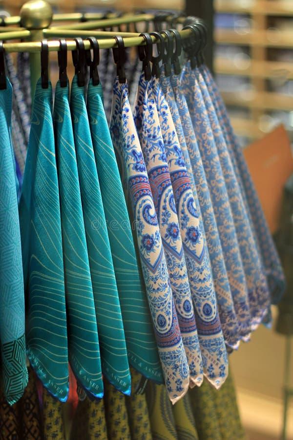 Colorful handkerchiefs. Arrangement of colorful handkerchiefs hanging in store display stock image