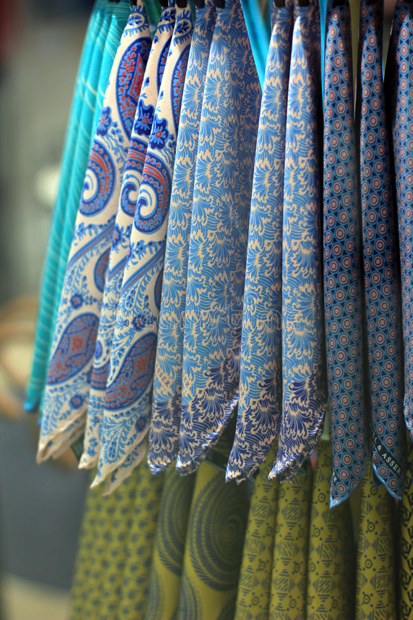 Colorful handkerchiefs. Arrangement of colorful handkerchiefs hanging in store display stock images