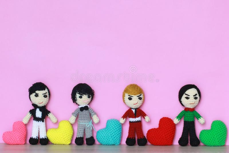 Colorful of Handmade crochet heart and crochet doll on pink background for valentines day stock images