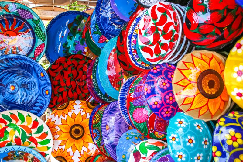 Colorful handmade decorative mexican plates with many patterns o. N the display on the local market in Puerto Vallarta stock photo