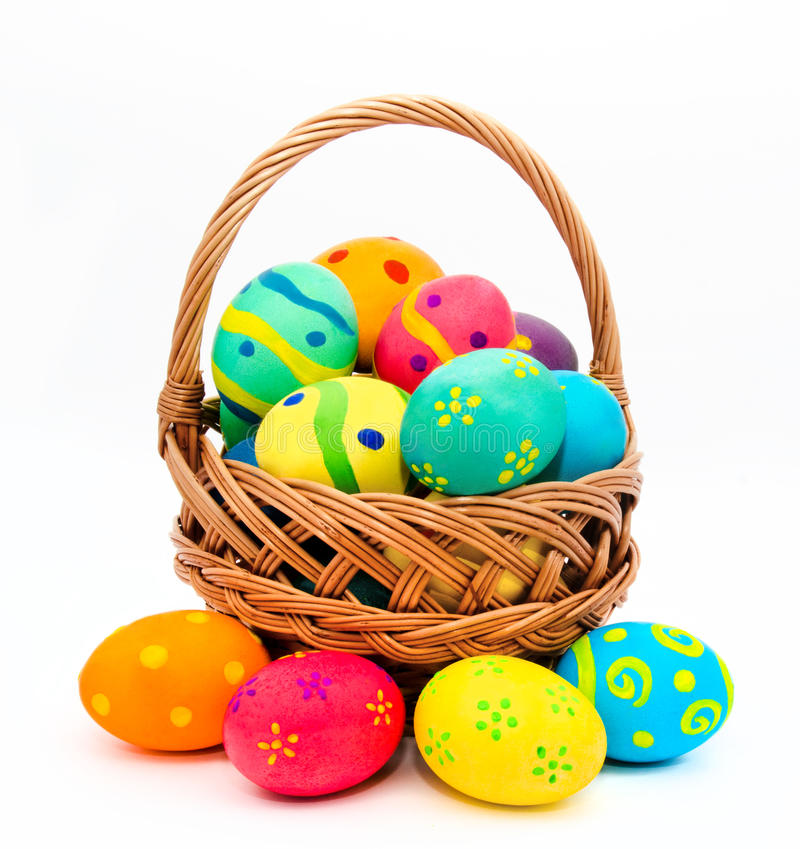 Colorful handmade easter eggs in the basket isolated on a white stock photography