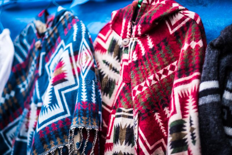 Knitted ponchos on nepalese market. Colorful handmade knitted poncho on nepalese outdoor market royalty free stock photos