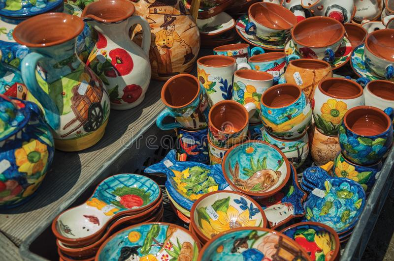 Colorful handmade porcelain pots and dishes. Colorful handmade porcelain pots and bowls, typical of the region, in a gift shop at the Serra da Estrela. The royalty free stock image