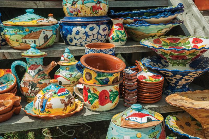 Colorful handmade porcelain pots and dishes royalty free stock images