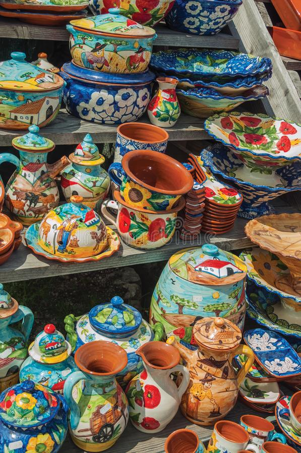 Colorful handmade porcelain pots and dishes. Typical of the region, in a gift shop at the Serra da Estrela. The highest mountain range in continental Portugal royalty free stock images