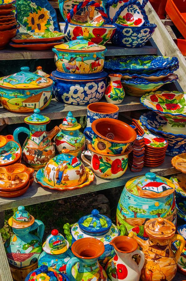 Colorful handmade porcelain pots and dishes. Typical of the region, on gift shop at the Serra da Estrela. The highest mountain range in continental Portugal stock images
