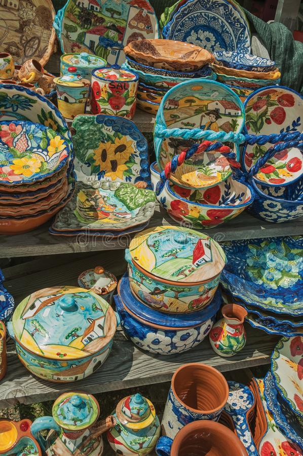 Colorful handmade porcelain pots and dishes. Typical of the region, in a gift shop at the Serra da Estrela. The highest mountain range in continental Portugal stock images