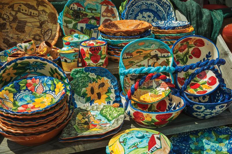 Colorful handmade porcelain pots and dishes. Typical of the region, in a gift shop at the Serra da Estrela. The highest mountain range in continental Portugal royalty free stock image