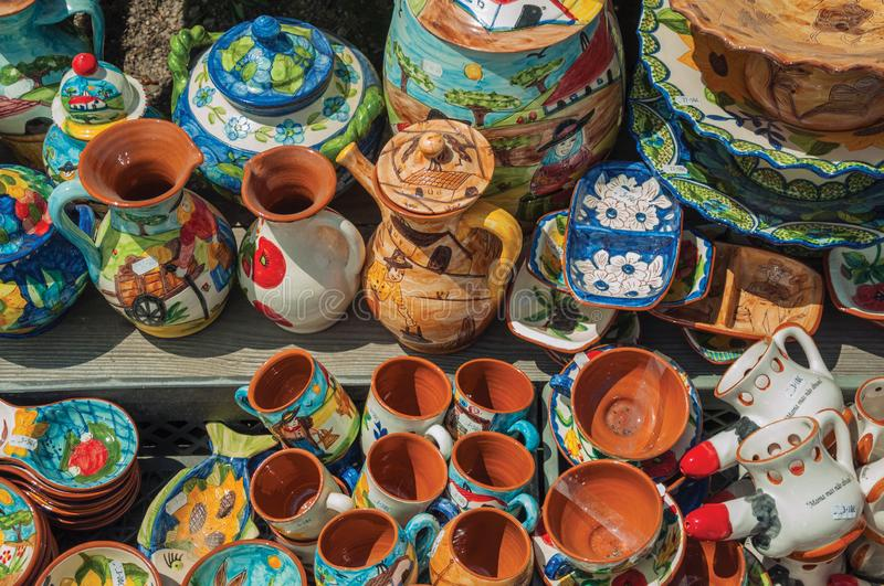 Colorful handmade porcelain pots and dishes. Typical of the region, in a gift shop at the Serra da Estrela. The highest mountain range in continental Portugal stock photography